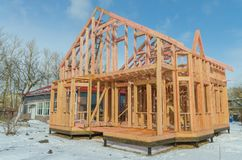 Construction of wooden frame house. Base, frame of a wooden house, racks and partitions Stock Photo
