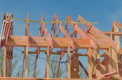 Construction of wooden frame house. Base, frame of a wooden house, part of the roof Stock Photography