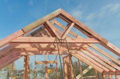 Construction of wooden frame house. Basis, a frame of the wooden house, fastening of overlapping of a roof Stock Images