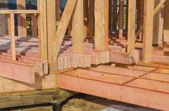 Construction of wooden frame house. Boards processed by fire-biological protection for construction, in a wooden house frame Stock Image