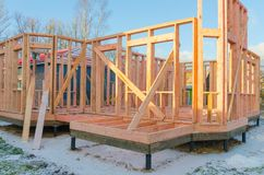 Construction of wooden frame houses, on pile foundations royalty free stock photos