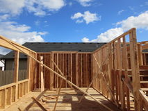 Construction of a wooden house. A beautiful view of an incomplete wooden house royalty free stock photos