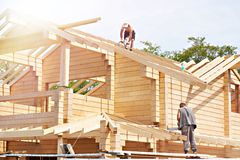 Construction of wooden house. Construction of a wooden house royalty free stock photos