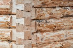 Construction of a wooden house made of logs. Corner part of a frame. Stock Photo