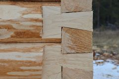 Construction of a wooden house made of logs. Corner part of a frame. Royalty Free Stock Images