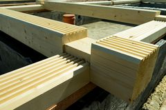 Construction of a wooden house made of profiled laminated veneer lumber. Bookmark corners. Construction of a wooden house made of profiled laminated veneer stock photography