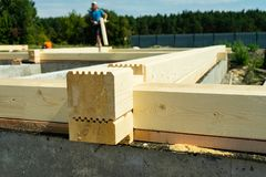 Construction of a wooden house made of profiled laminated veneer lumber. Bookmark corners stock photography