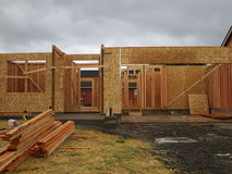 Construction of a wooden house. This is a neighborhood in Vancouver Washington where new houses are being built. I took this photo on a rainy day royalty free stock photo