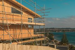 Construction of a wooden house with a sea view. Whangaparaoa, Auckland, New Zealand, June 2015, horizontal photo, photo is usable on picture post card Stock Image