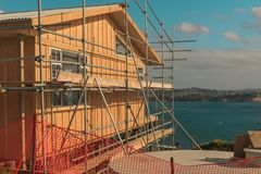 Construction of a wooden house with a sea view. Whangaparaoa, Auckland, New Zealand, June 2015, horizontal photo, photo is usable on picture post card Royalty Free Stock Photos