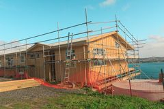 Construction of a wooden house with a sea view. Whangaparaoa, Auckland, New Zealand, June 2015, horizontal photo, photo is usable on picture post card Royalty Free Stock Images