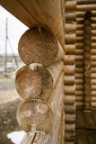 Construction of a wooden house. Selective focus on raw logs wooden houses Royalty Free Stock Photos