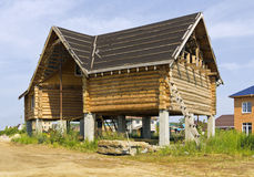 Construction a wooden house on stilts Royalty Free Stock Photos