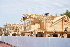 Construction of wooden houses. Construction of a wooden houses stock photo