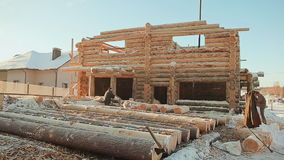 Construction of wooden houses. Winter construction site. Canadian angle masonry. Canadian style. stock video footage
