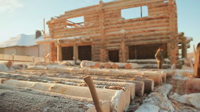 Construction of wooden houses. Winter construction site. Canadian angle masonry. Canadian style. Wooden house made of stock video footage