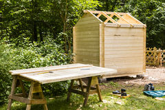 Construction of a wooden hut. In a garden Royalty Free Stock Photo
