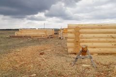 Construction of wooden log cabins. Unfinished wooden log cabins on the field Stock Photo