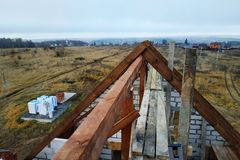 Construction of a wooden roof of the curved rafters at the beginning of the roof construction. 2018 stock photography