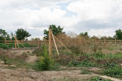 Support fence. Construction of a wooden rural fence. Construction of a wooden rural fence. Support fence royalty free stock photo