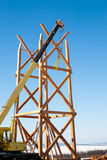 Construction of wooden towers using a mobile crane Stock Image