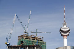 Construction work. An image of a construction work with tower cranes royalty free stock photo