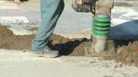 Construction work 4 8 2 angles. A man operates a dirt compactor. The is a clip from a series about construction work stock video