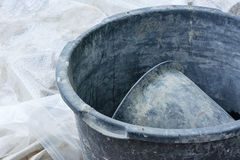 Construction work. A cement bucket on a plastic film stock photography