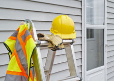 Construction Work Gear. Work gear on step ladder Stock Image