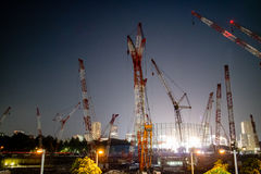Construction Work getting ready for the Tokyo 2020 Olympics 3. Cranes filling the skyline of Tokyo to build a stadium for the 2020 Olympics Royalty Free Stock Image