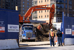 Construction work in New York City. View of a construction field in Manhattan, the heart of New York City. Two workers people with helmet are watching. Huge blue stock photo