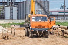 Construction work on pipe laying of pipeline into trench using a royalty free stock image