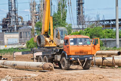 Construction work on pipe laying of pipeline into trench using a Royalty Free Stock Photos