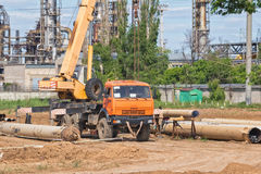 Construction work on pipe laying of pipeline into trench using a Stock Images