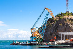 Construction work in port. Construction work at the port dock crane Royalty Free Stock Photography