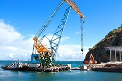 Construction work in port. Construction work at the port dock crane royalty free stock image