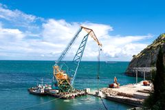 Construction work in port. Construction work at the port dock crane stock photography