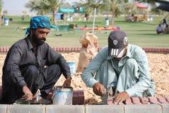 Construction work in public park. Construction workers are making bricks floor, in Karachi,Pakistan Stock Photos