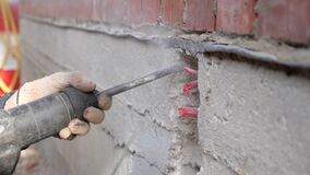 Construction work. Puncher making holes in concrete.