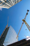 Construction work site. On blue sky background Stock Photos