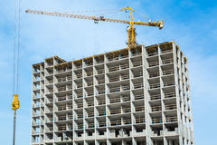 Construction work site and high-rise crane. Construction work and building crane.  Construction work and building crane Royalty Free Stock Image