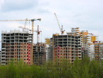 Construction work site place concept with cranes Stock Photos