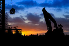 Construction Work Slhouette at Sunrise Stock Photography