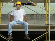 Construction Worker 1. Construction Worker sitting on staging on site stock images