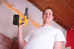 Construction worker. A construction worker with a drill Stock Image