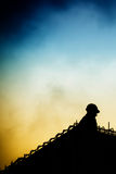 Construction worker. Silhouette of a construction worker against a dramatic sky Stock Photography
