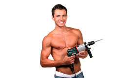 Construction worker. Handsome young topless construction worker with drill royalty free stock photo