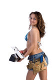 Construction Worker. Cute young woman in Daisy Duke denim shorts, bikini top and a framers tool belt as if she were a construction worker Royalty Free Stock Photo