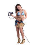 Construction Worker. Cute young woman in Daisy Duke denim shorts, bikini top and a framers tool belt as if she were a construction worker Royalty Free Stock Image