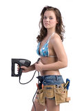 Construction Worker. Cute young woman in Daisy Duke denim shorts, bikini top and a framers tool belt as if she were a construction worker Royalty Free Stock Images